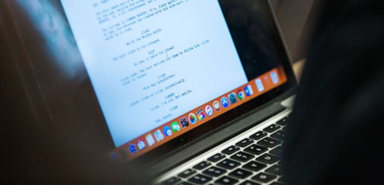A screenplay on a laptop screen